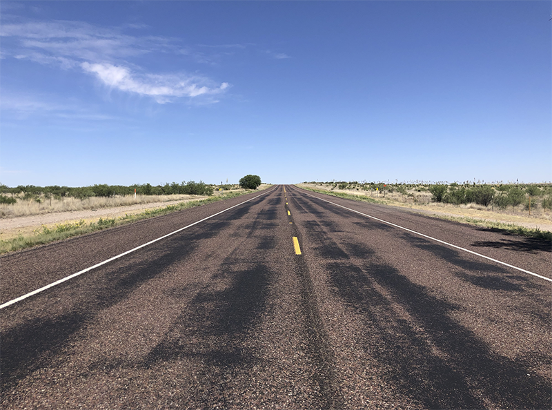 photo of west Texas road and blue sky