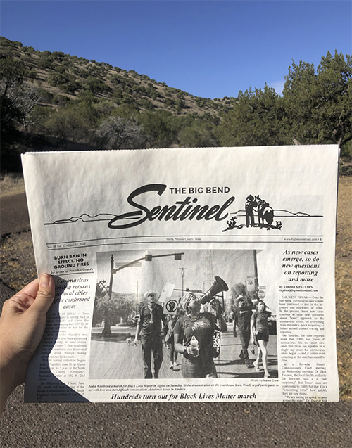 Photo of reader holding The Big Bend Sentinel