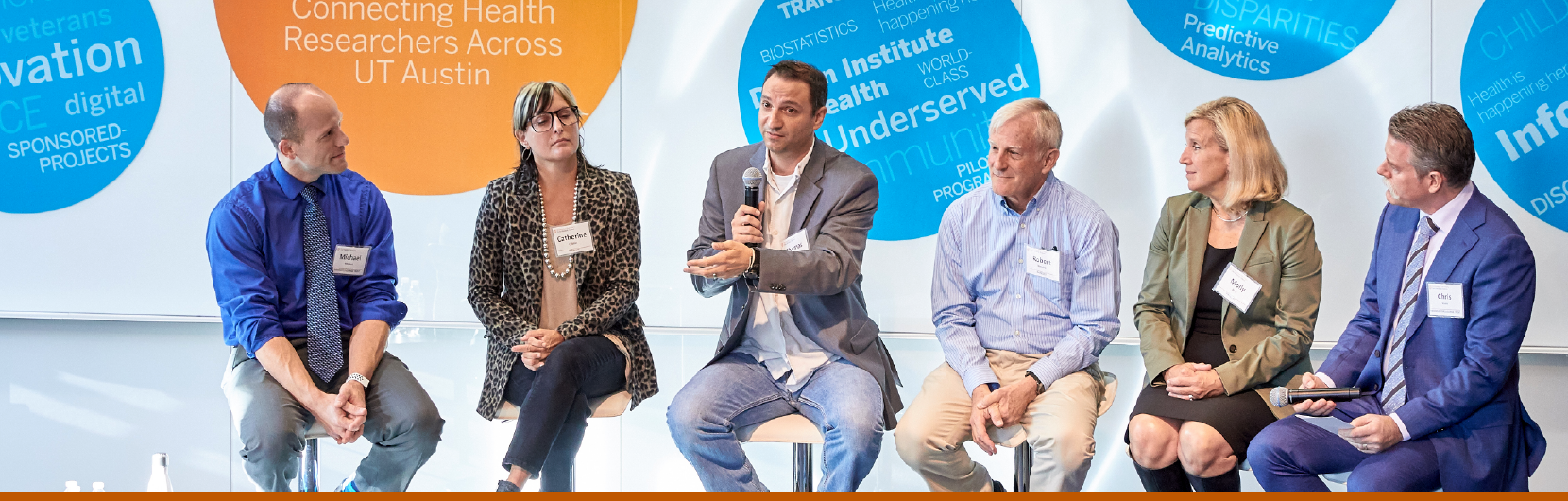 A panel of speakers at a Dell Medical School event