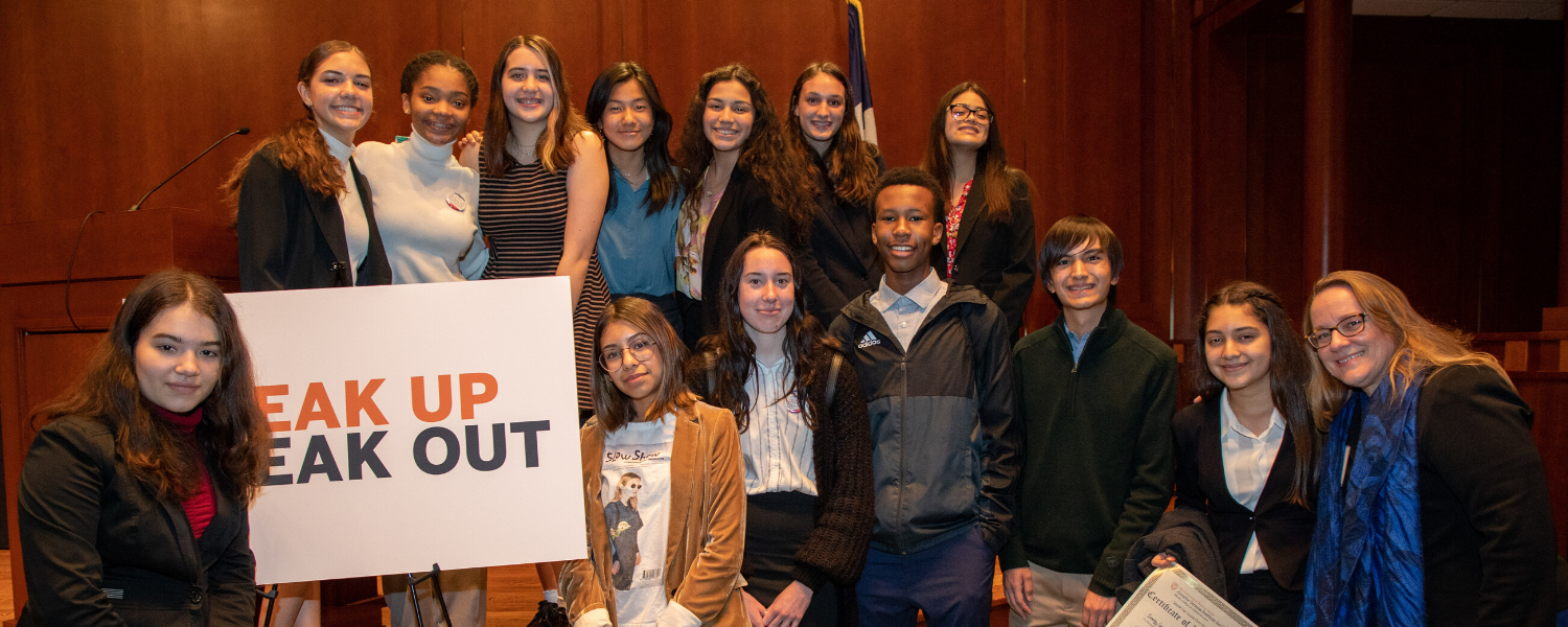 students at state capitol with Speak Up Speak Out sign
