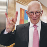 Stan Richards gives the Hookem Horns sign